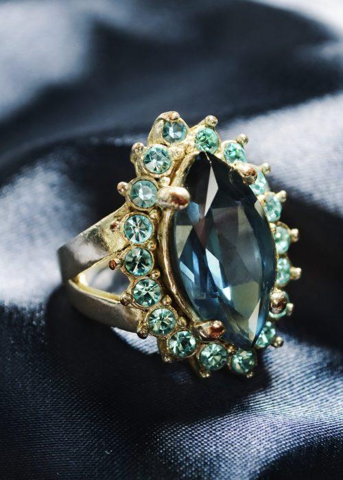 Diamond ring on blue silk